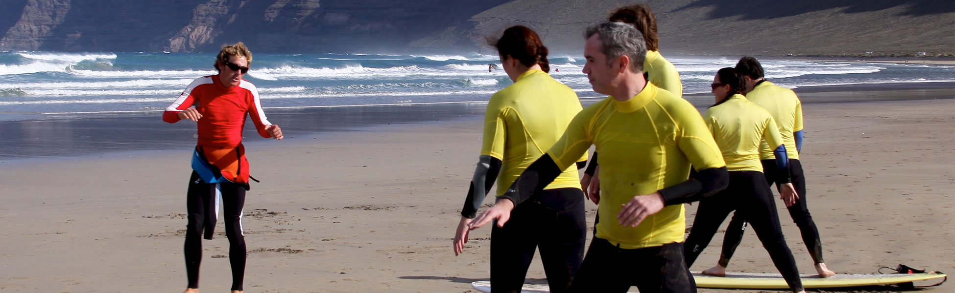 teaching surfing on famara beach